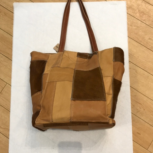 77f5b40198 New - Brave Leather Tote